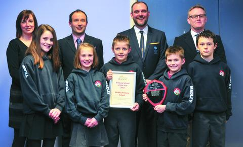 Madley receive their award from Stafford Murray, back row (left to right): Sue Jenkins, Tom Hutton, Stafford Murray, headteacher Lee Batstone; front: Lucy Jenkins, Freya Batstone, Ben Goodman, Morgan Wells, Joe Jenkins