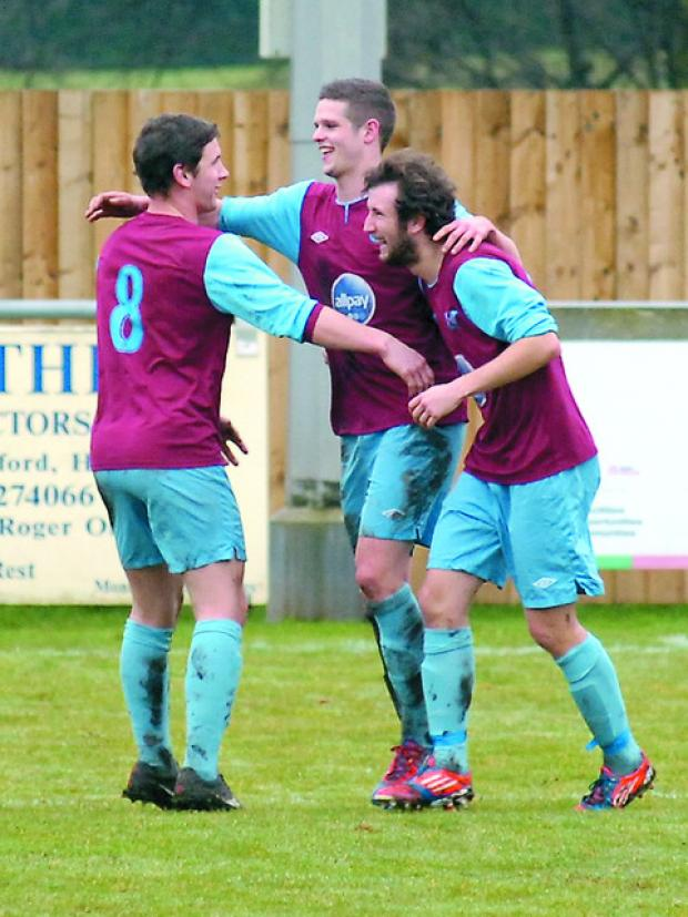 Aidan Thomas celebrates his third goal with team-mates Jamie Cuss (left) and Alex O'Leary.