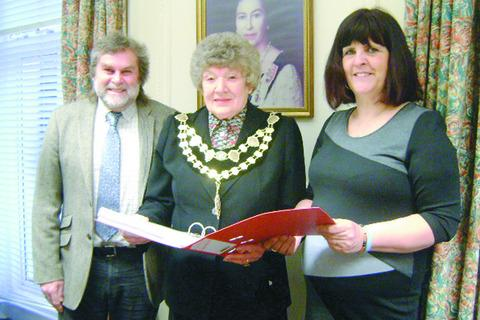 Richard Aird, head of Barrs Court Special School, and Alison Sheppard, present their petition to councillor Olwyn Barnett (centre).