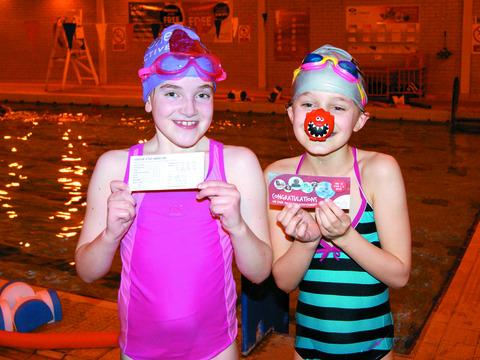 Two Orleton Primary School pupils, Abigail Hall and Millie Harris, swam half a mile to raise £80 for Comic Relief.