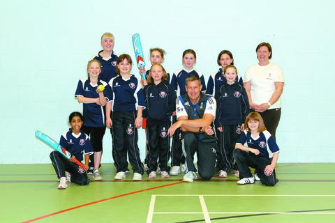 Ashley Giles (front row) at Herefordshire Under-11 girls' cricket training at Whitecross School last Friday. His sister Tracy Hodgson (back, right) is training the team with Anna Robertson (back, left).