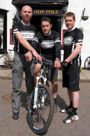 Three Herefordshire cyclists aim to visit 100 pubs in one day to raise money for local charities..