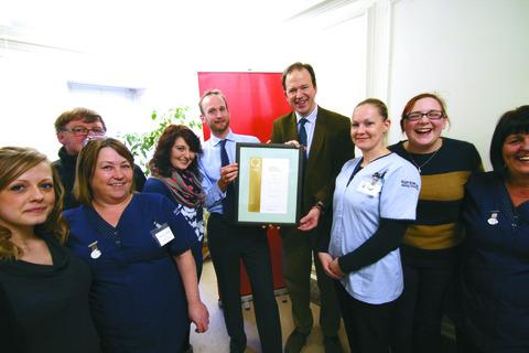 Jesse Norman (third from right) with Kemble Care managing director Peter King and mentors and trainers (from left) Amy Evans, Graham Downing, Sally-Ann Ford, Mim Hodgson, Louise Craddock, Lydia Ingram and Annette Saunders.