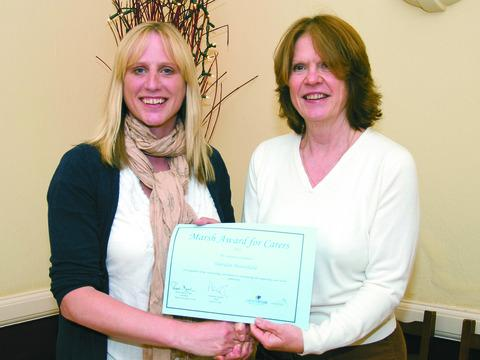 Sheridan Butterfield (left) receives her certificate from Jacqui Bremner, director of Herefordshire Carers Support