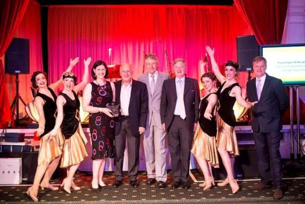 From left to right (exclucing dancers) are: Alex Pattison-Appleton; Dennis Haines (CEO of Badger Office Supplies); Rod Young (Cartridge World chairman and Global CEO); Hugh Pattison-Appleton; John Richardson (president of Europe, Middle East and Africa, c