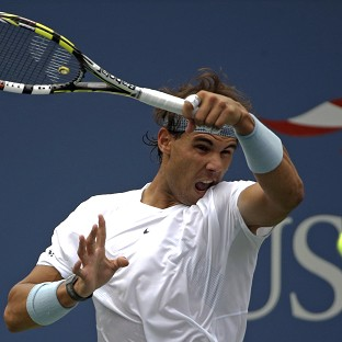 Rafael Nadal, pictured, eased to victory over Ryan Harrison (AP)