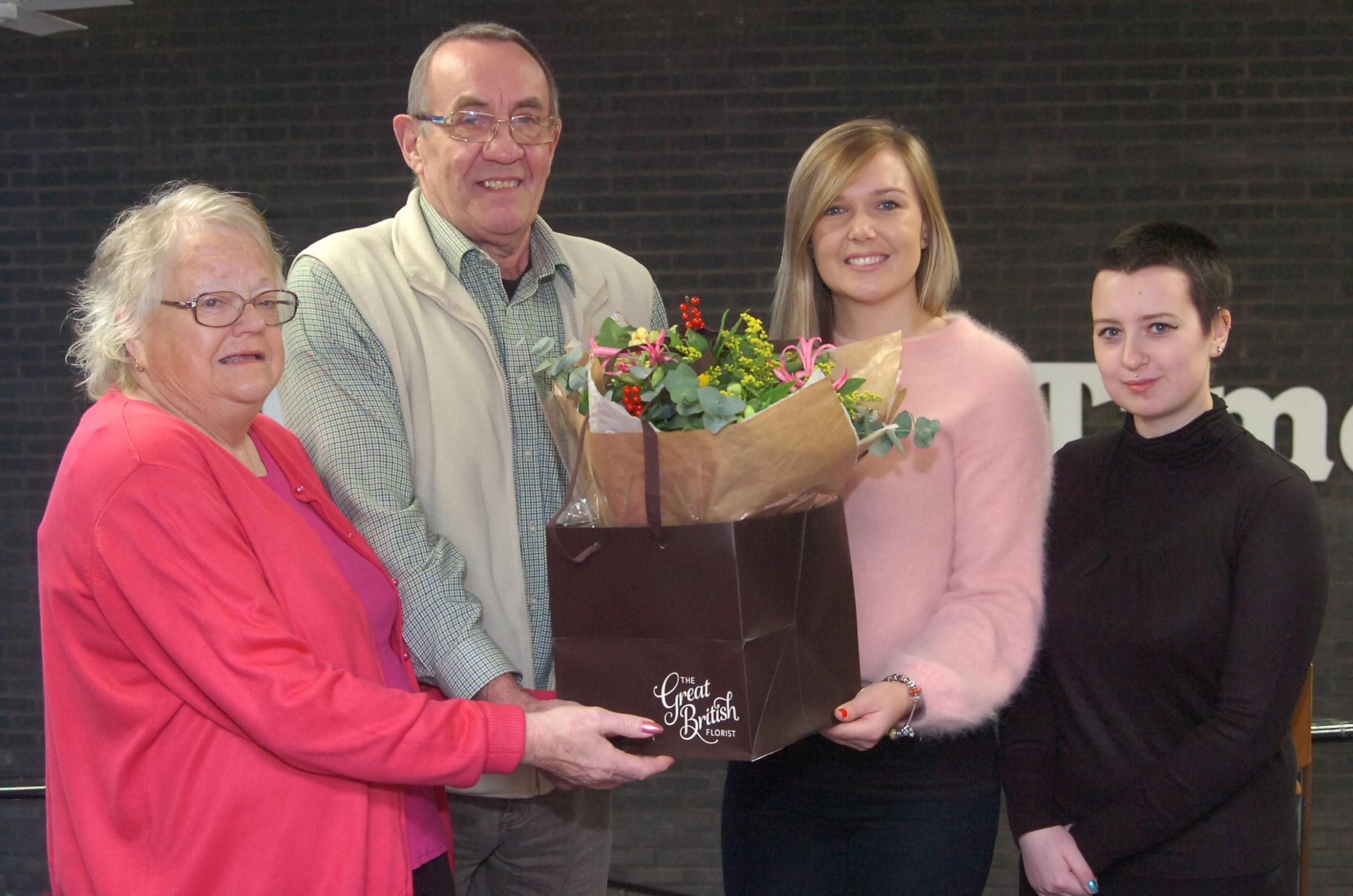 Ros and Ray Sykes receive their Herefordshire Hero bouquet from Izzy Winney of the Great British Florist and Hereford Times reporter Lydia Johnson. Picture by James Maggs.