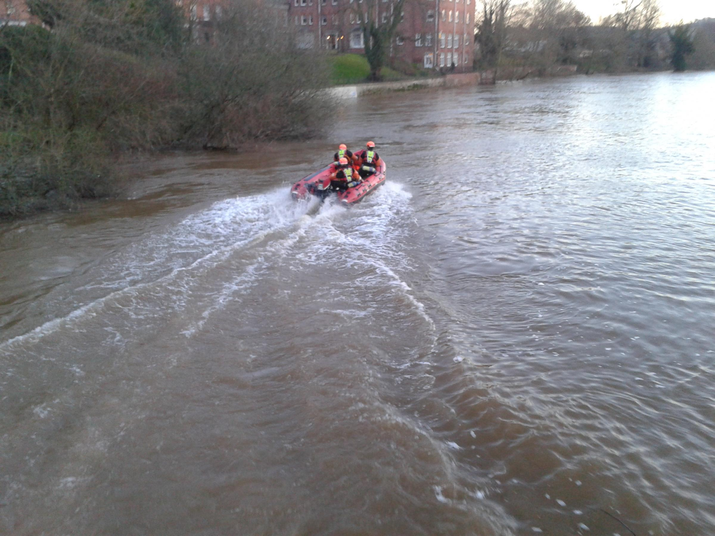 A water rescue boat pictured near the Victoria Bridge in Hereford.