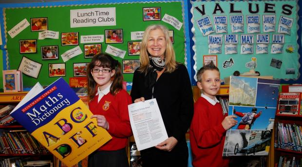 Hereford Times: Broadlands Primary School executive headteacher Sue Woodwow celebrates the school's Ofsted report with head girl Abi Green and head boy David Golas. (4231989)Picture: Eye Contact Media.