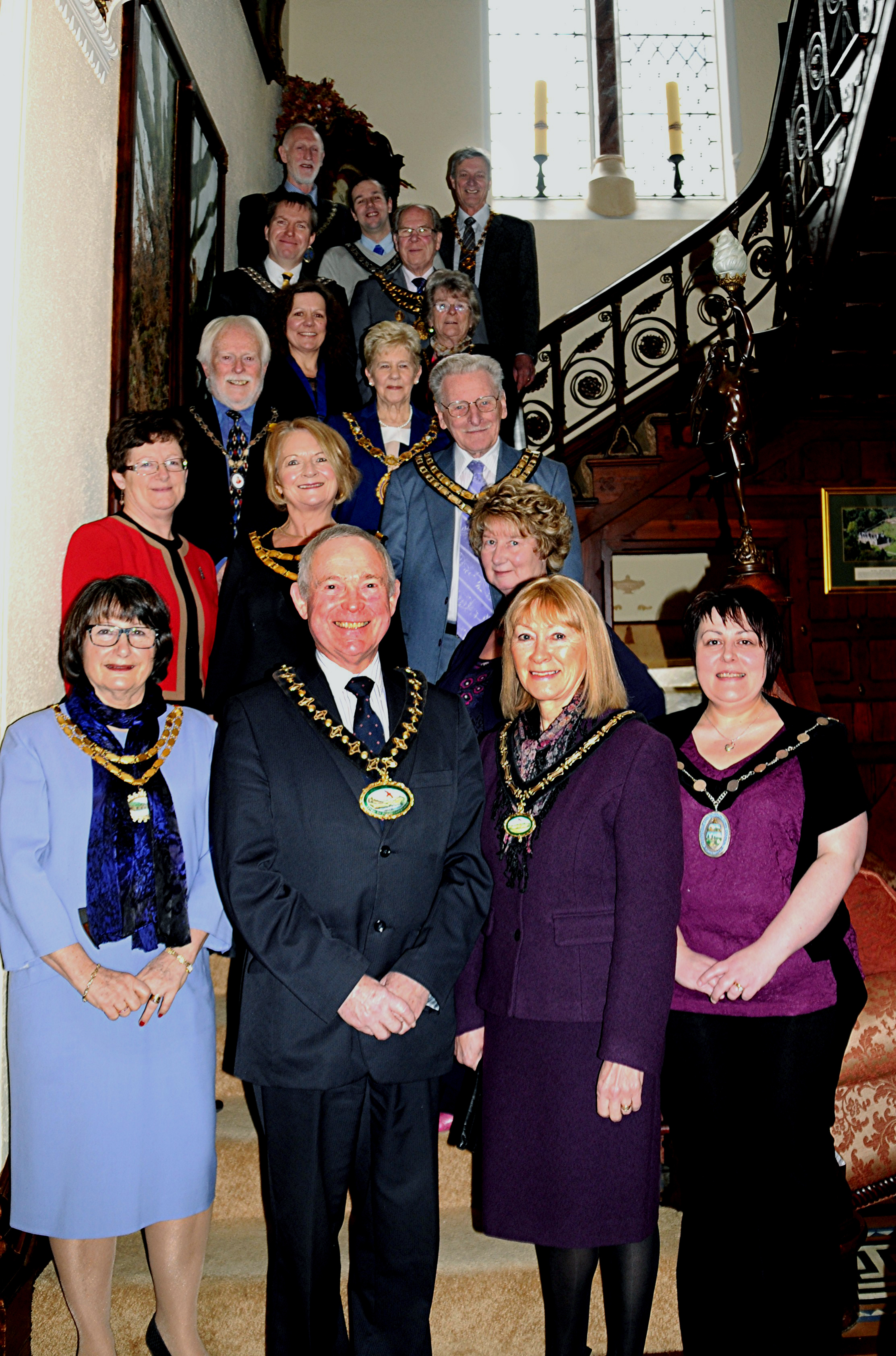 The chairman of Powys County Councillor John Brunt and his wife are pictured with the mayors at the reception. Photo by Brights Studi