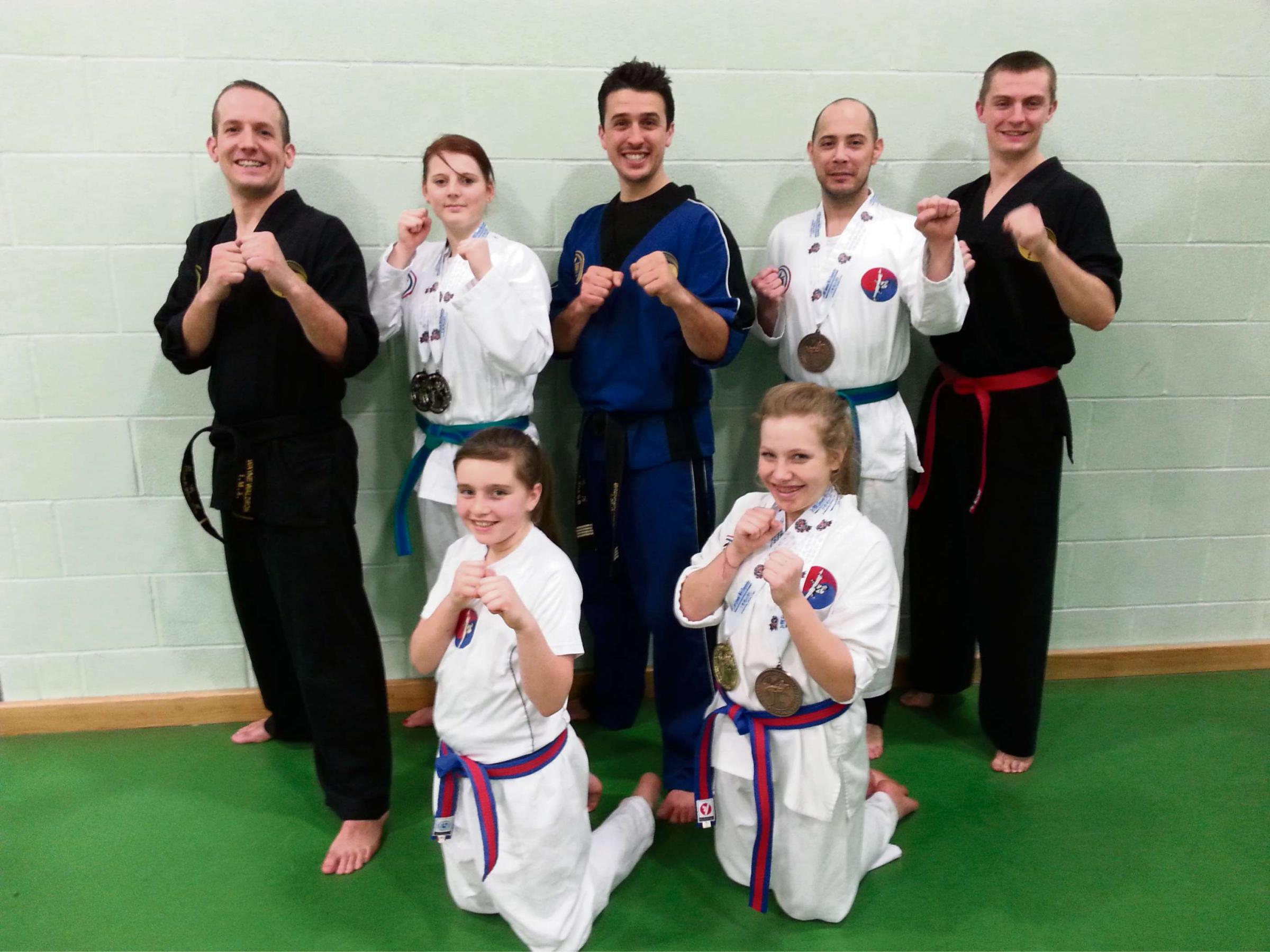 Some of the Page Family medallists, back row (left to right) squad coach Wayne Waldron, Ellie Morris Silver Sparring and Patterns, chief instructor Brennen Page, John Ande
