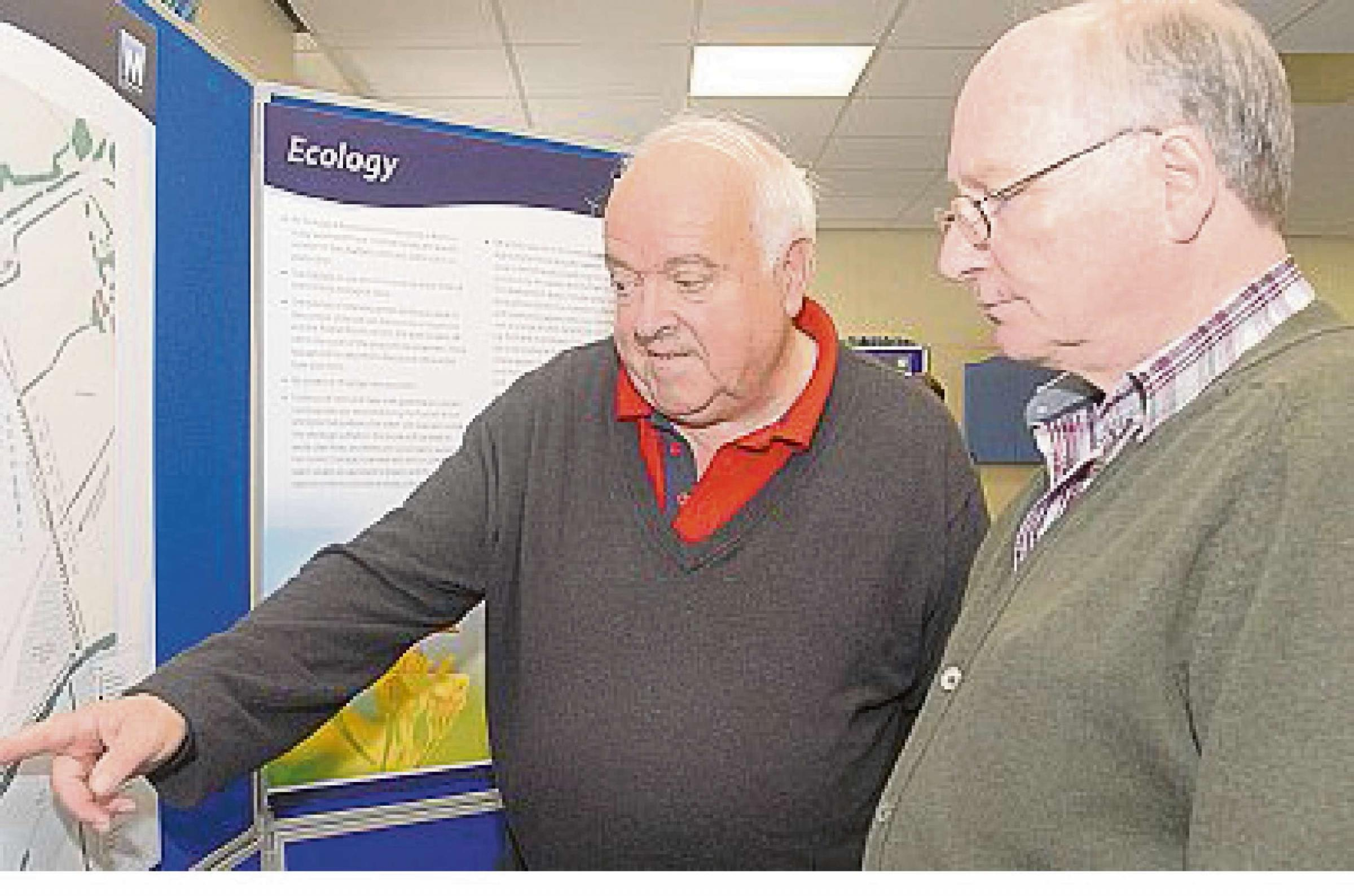 Peter Crocker and Andrew Talbot study the plans at a public exhibition held in September.