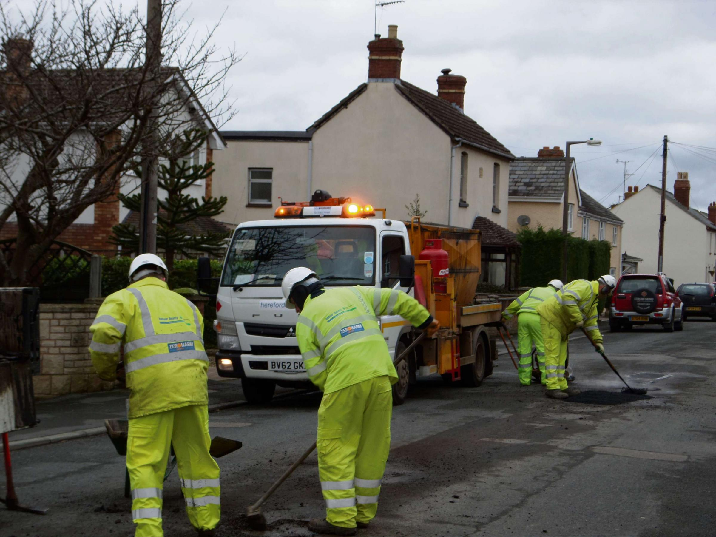Potholes being repaired in Westfields, Hereford, by contractors as part of a £3.5m bid to repair the county's damaged roads.