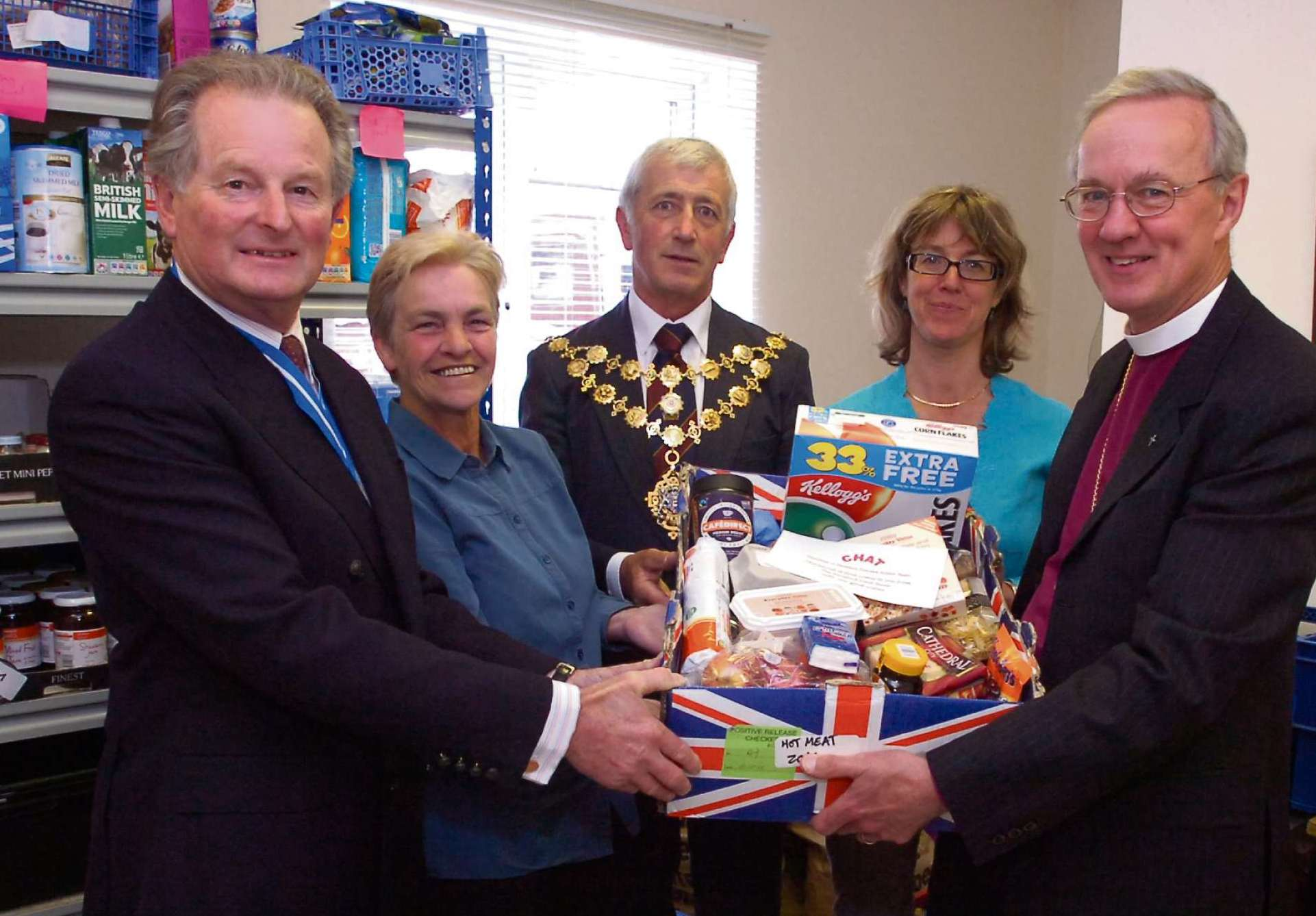 (l-r) Former Herefordshire High Sheriff Bob Tabor visiting the food bank last year with volunteer Carol Plant, Mayor of Hereford Phil Edwards, food bank administrator Alison Russell, and the very Rev Anthony Priddis.
