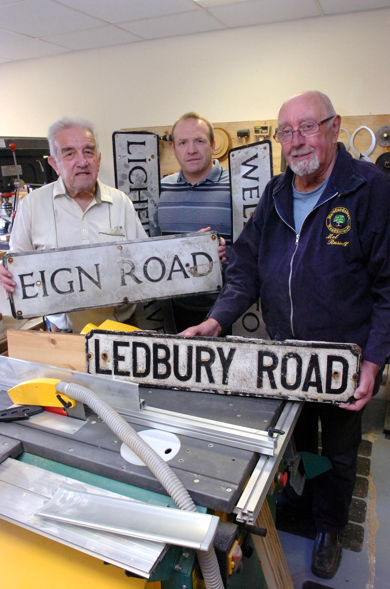 Repairing streets signs – and saving the taxpayer cash – are Tony Archer, Councillor Jim Kenyon and Mel Russell. Picture by James Maggs.