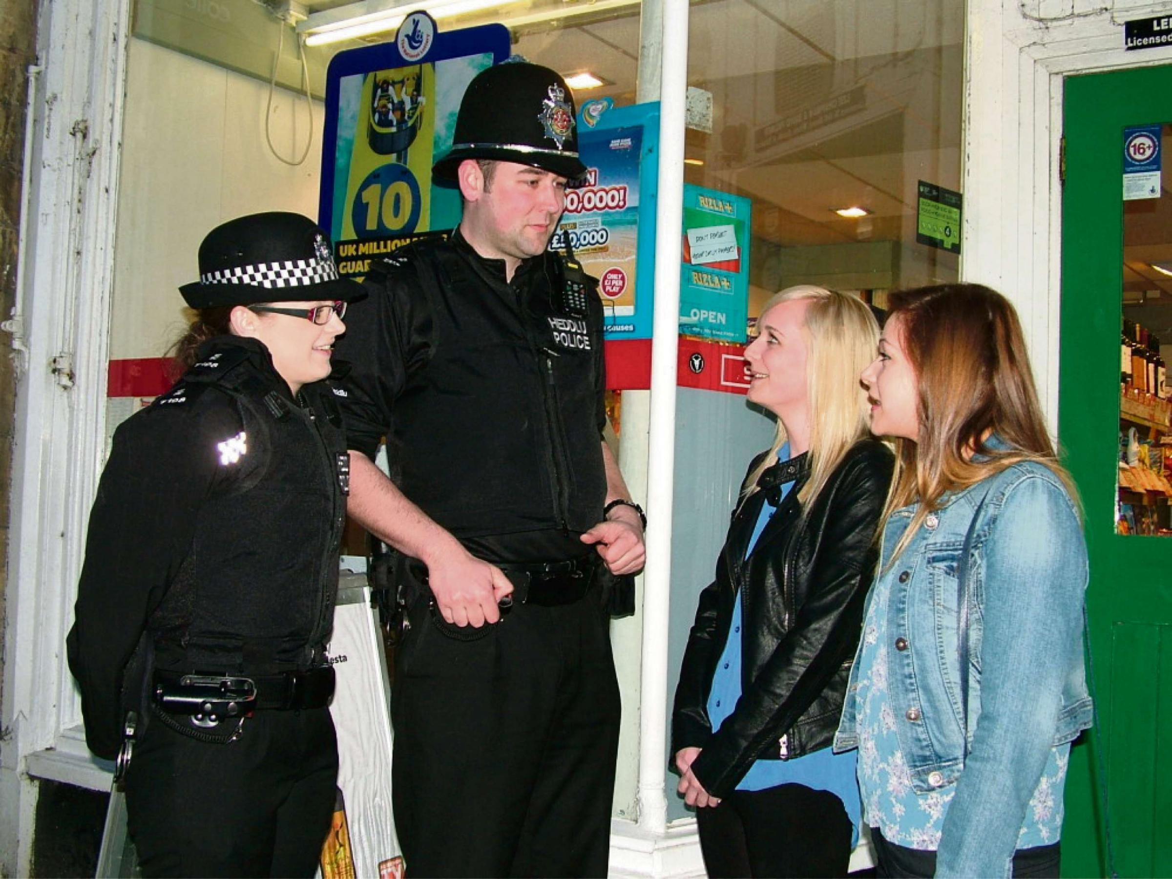 Special Constables Jess Barrett and Jim Cooke in Knighton doing some community policing and talking to Sophie Price from New Radnor and Sophie Evans from Knighton.