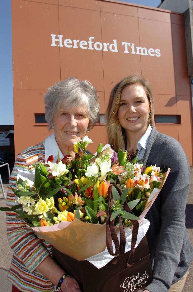 Hereford Times: Herefordshire Hero Jean Heath (left) receives her bouquet from Izzy Winney of the Great British Florist. Picture by James Maggs. (5501313)