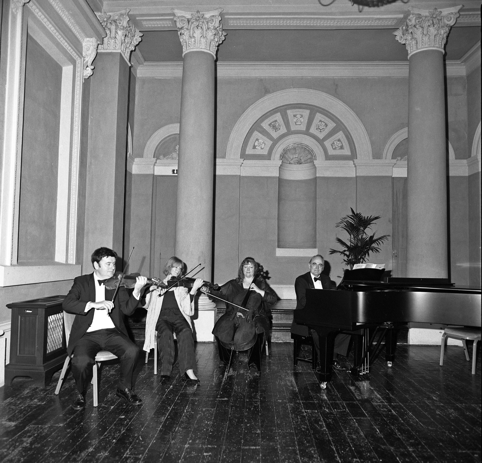 A piano quartet performing at the venue in 2000.