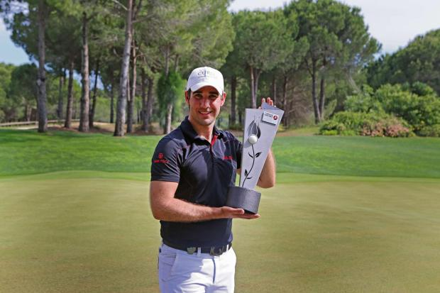 Oliver Farr shows off his Turkish Airlines Challenge trophy after his first European Challenge Tour win.Picture by Maestro Photography Services.