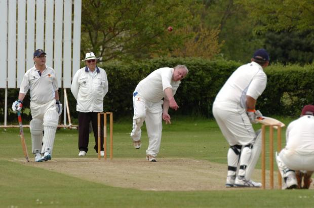 Hereford Times: Herefordshire Cricket over-50's v Shropshire over-50's. Eastnor.Ian Gunthorpe bowling. (6249662)