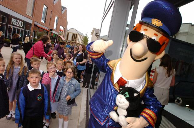 Marlbrook Primary School children meet Postman Pat.