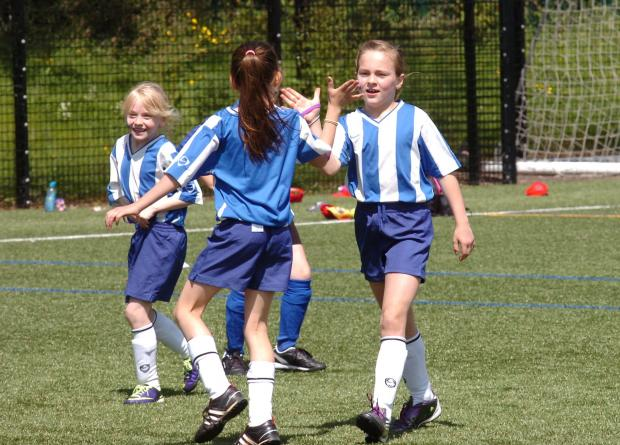 Hereford Times: Madley Primary School's Mathilda Kitson is congratulated after scoring against Kington Primary. (6421695)Picture by James Maggs.