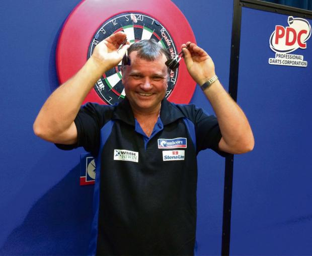 Ledbury's Terry Jenkins celebrates his triumph in Crawley. Photograph: PDC.