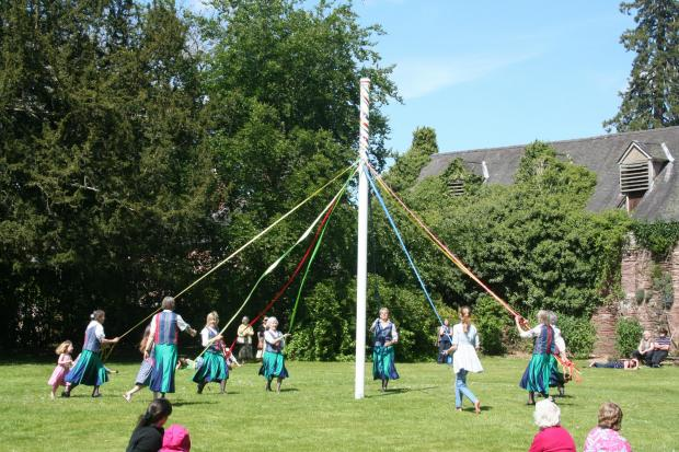 Hereford Times: Maypole dancing with the grounds of Hampton Court.