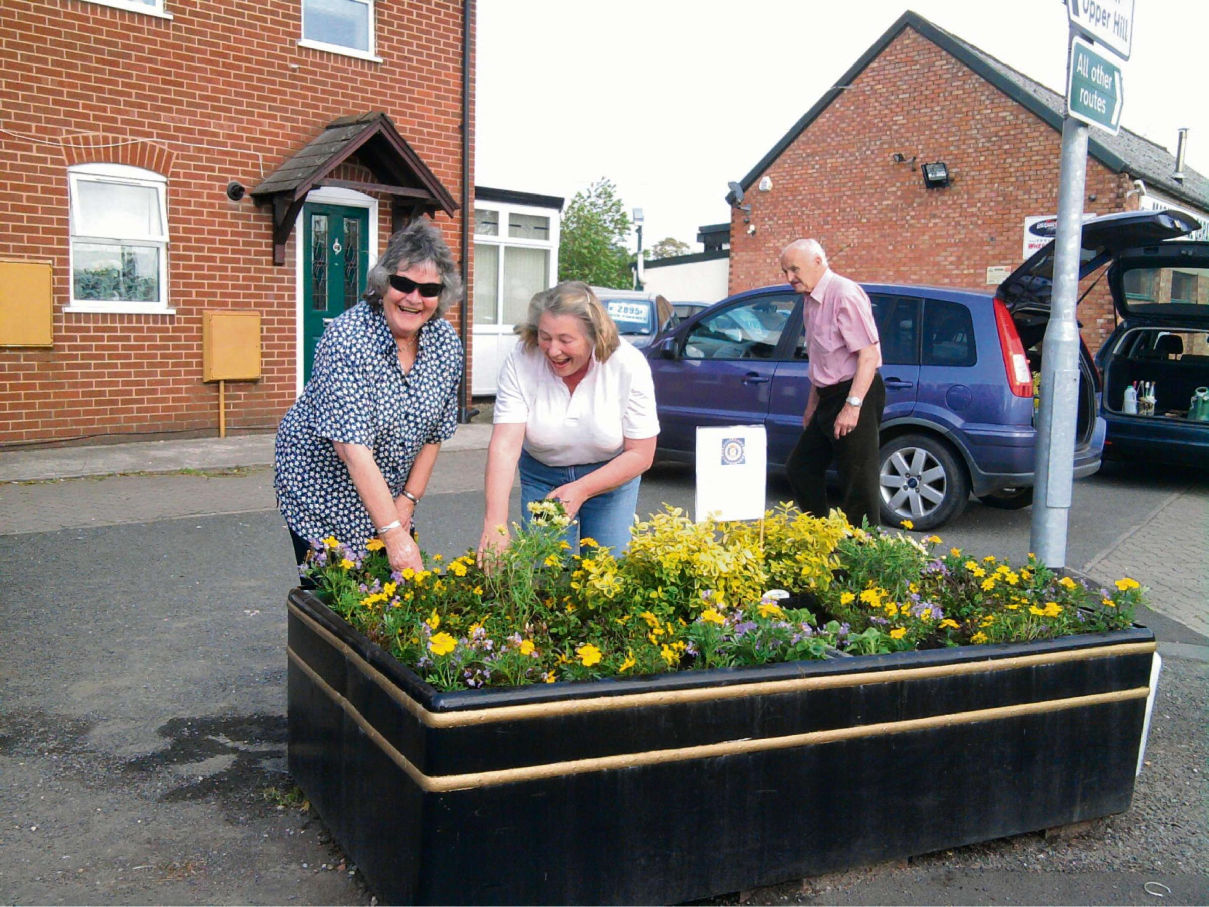 Photographed working on one of the planters is left to right Terry Mackay and Penny Usher.