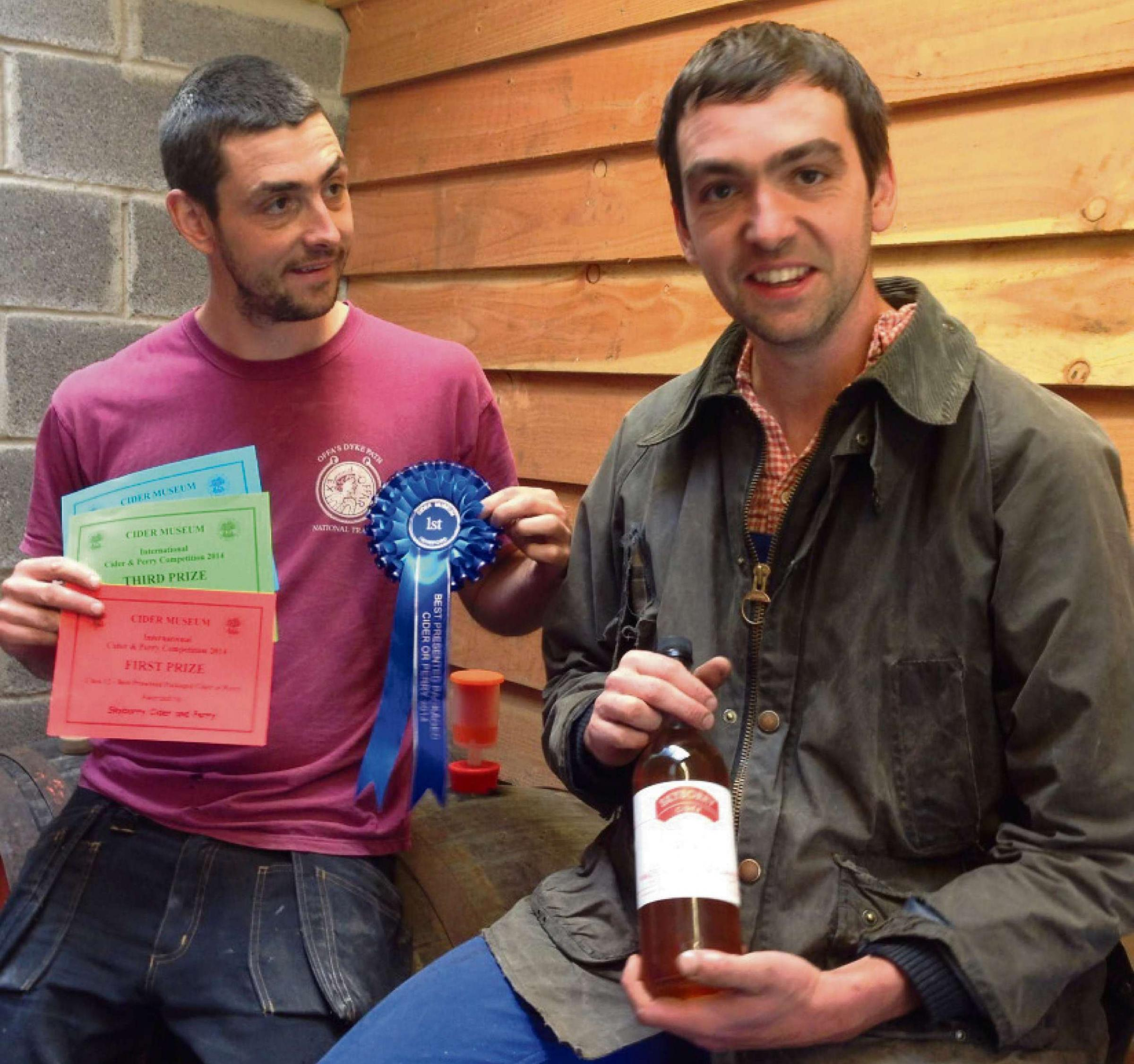Dani (right) and Adam Davies in their cider shed with their awards.