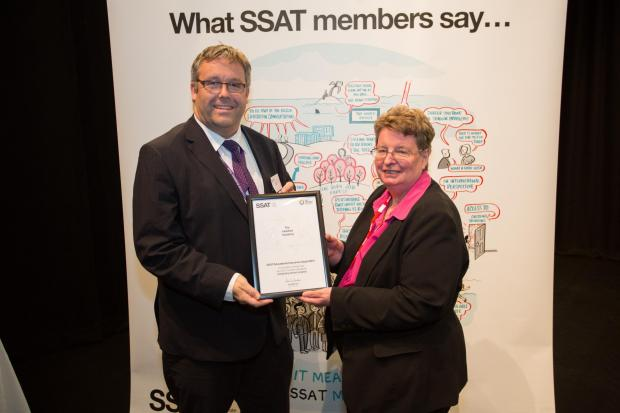 Pete Johnson, commercial director at The Hereford Academy, pictured receiving their award in recognition of the progress of their students from Sue Williamson, chief executive of SSAT, the Specialist Schools and Academies Trust.