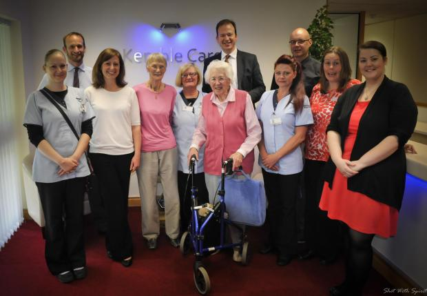 Hereford Times: Hereford MP Jesse Norman pictured with staff and clients at Kemble Care's new offices.