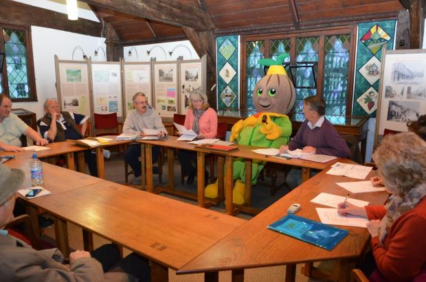 The Newent Onion Fayre committee, including mascot OnionEd, discuss ideas for 2014's fayre.