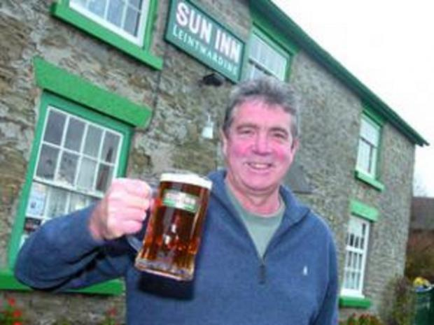 Landlord Gary Seymour celebrates after the pub was voted Herefordshire pub of the year by CAMARA