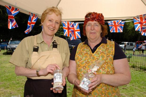 Hereford Times: From left:  Sue Pearce (Tudor Sweets) and Elaine Weatherhead with jars of sweets which were being sold to raise money for the Royal British Legion. (7264914)Photo: James Maggs.