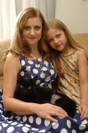 Layla Chester with daughter Ella and pet cat Marley. Photo: JAMES MAGGS.