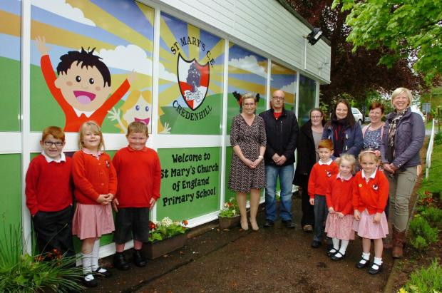 New mural unveiled at St Mary's C of E Primary School, Credenhill. From left: Karen Pritchard (business manager), Dean Bruton (Print Plus), Jenny Maynard-Watkins (PTFA), Laura Wooles (chairman, PTFA), Julie Skinner (office assistant), Paula Ferris (PT