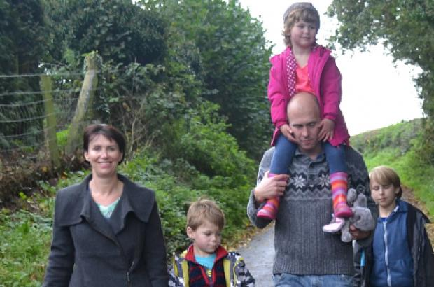 Alison and Phil Clarke take a country walk with their children.