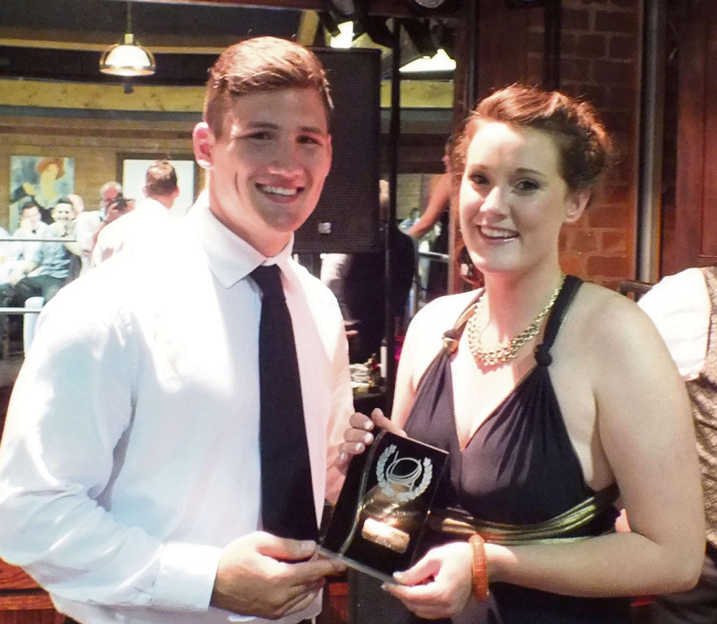 Women's player of the year, Hannah Conroy receives her award from Guy Thompson.