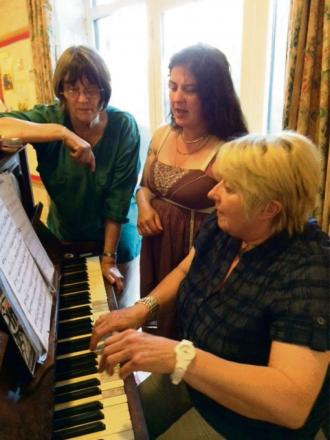 From left Lorna Firth, musical director, Jess Squires, member of the company and Kath Ainsworth, accompanist rehearsing for the production.