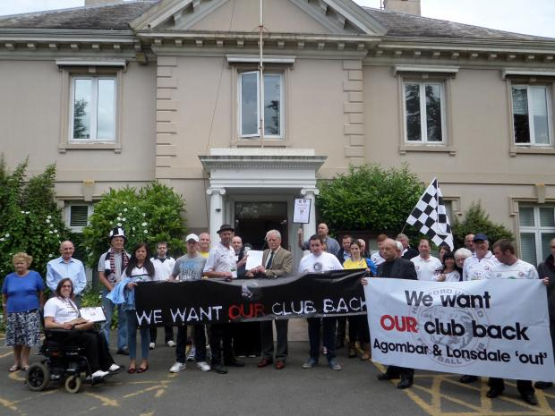 Hereford United supporters protest at Herefordshire Councils's Brockington HQ