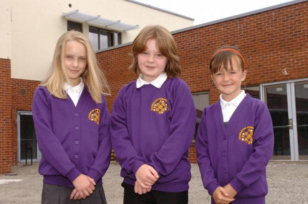 Hereford Times: The new uniforms unveiled for Leominster's new primary school which opens in September.From left is Anwen Gluyas, Ethan Pryce, Ella Bowden. (7544756) Pic: JAMES MAGGS.