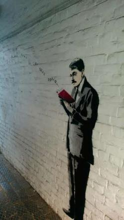 The 'Banksy' in an alleyway off High Street, Ledbury.