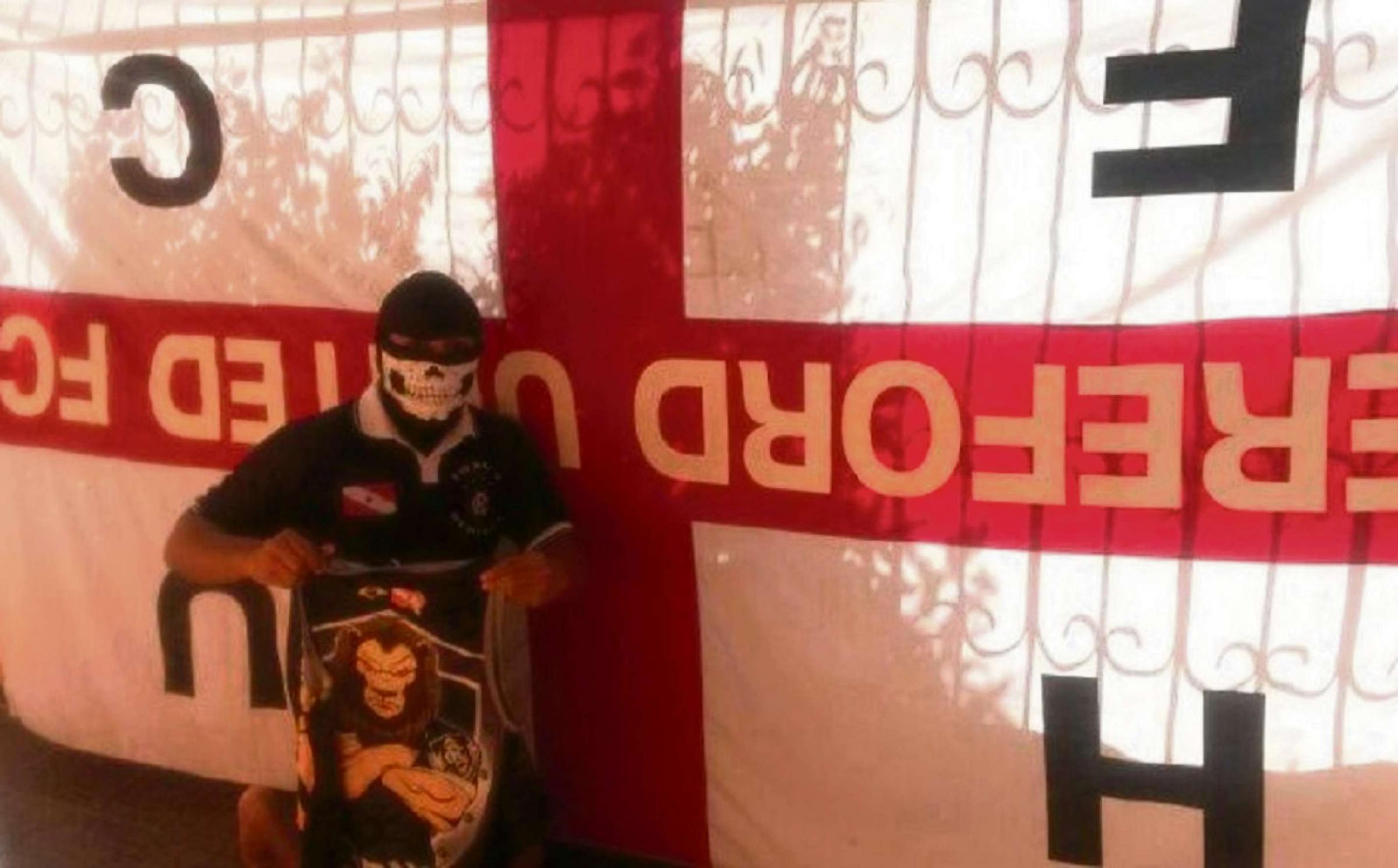 A Brazilian fan next to the Hereford United flag that was allegedly stolen.