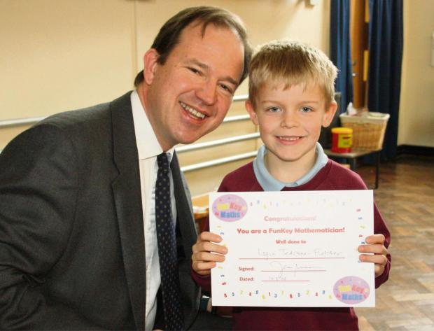 Hereford MP Jesse Norman with Logan Teastone-Fletcher, who completed the maths task.