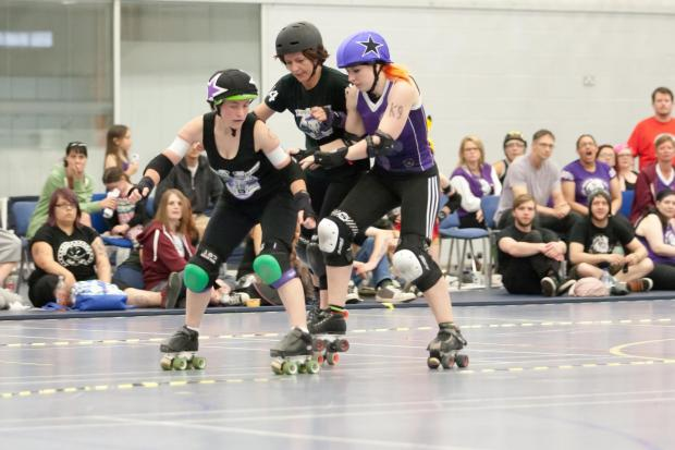 Becce Turner jamming for Hereford, with blocker Julie Truelove and the North Wales Jammer #K9PIcture by Pete Florey of MDP Images