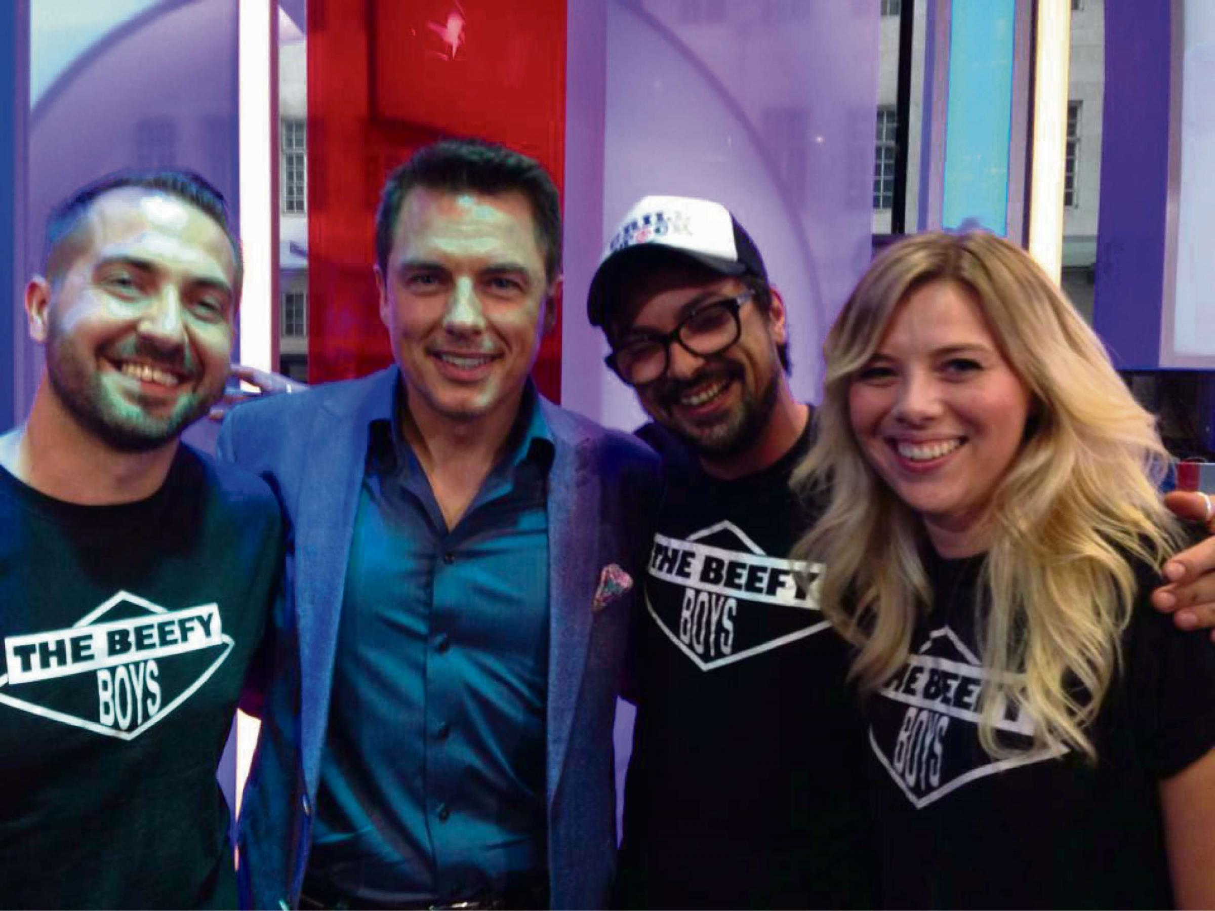 Beefy Boys founders Daniel Mayo-Evans and Anthony Murphy with his partner Jo Marshall on set at The One Show with John Barrowman.