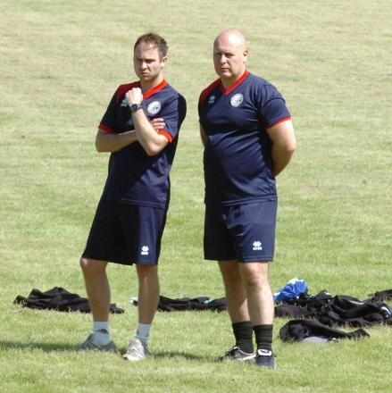 New manager Jon Taylor (right) with ex-physio Jonny Evans.