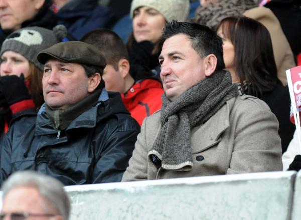 Tommy Agombar (left) and Jed McCrory sit together in the crowd at a Swindon Town match. Photograph: Swindon Advertiser.