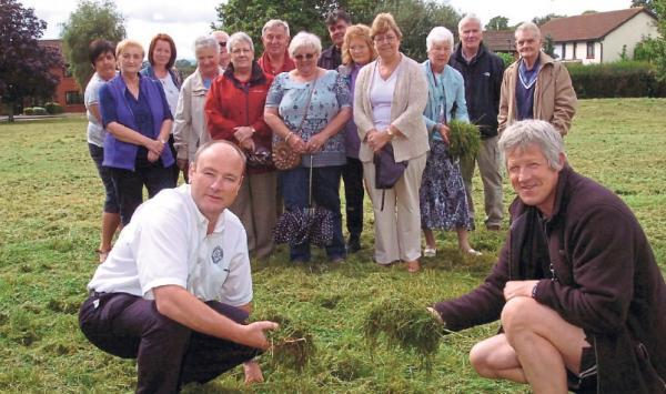 Sean Edwards and Jim Cotterell in front of other Kings Acre residents who are not happy with the lack of grass cutting.